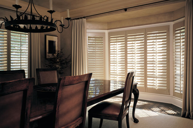 Wood shutters on bay windows